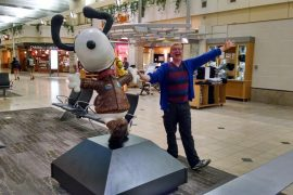 Nick posing with one of the Snoopy sculptures in the Minneapolis airport in Minnesota.