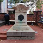 Travel to cemetery to visit Edgar Allan Poe's grave in Baltimore Maryland